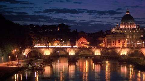 Left-to-right pan of dome of St. Peter's Basilica and Ponte Sant'Angelo. EDITED Footage