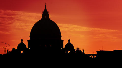 Close up of St Peter's Basilica silhouetted against a sunset Footage