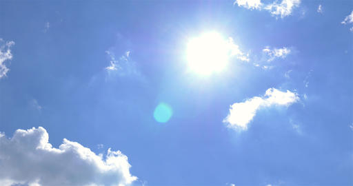 Sun On Blue Sky With White Cumulus Clouds Footage