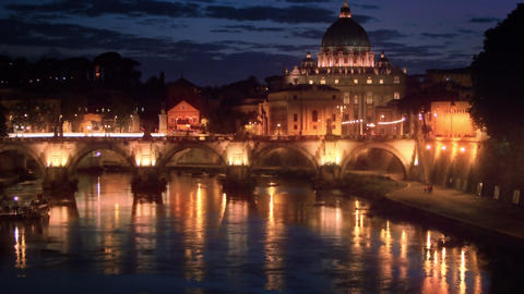 Tilt up footage of Ponte Sant'Angelo and dome of St. Peter's Basilica Footage