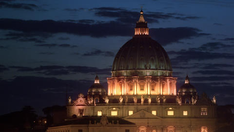 Close up footage of dome of illuminated St. Peter's Basilica at night Footage