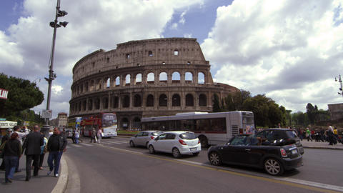Pedestrians and Traffic in front of the Colosseum in Rome Italy Footage