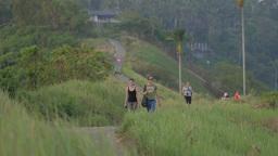 Tourist Couple Walking On Ridge Path,Ubud,Indonesia stock footage
