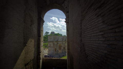 View of the Arch of Constantine framed by a window in the Colosseum Footage