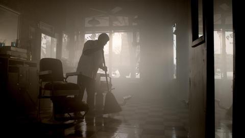 Barber sweeping floor Live Action