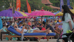 Man Sitting On Reclining Beach Chair At Restaurant,Kuta,Indonesia stock footage