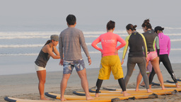 Surf instructor and students on beach,Kuta,Indonesia Footage