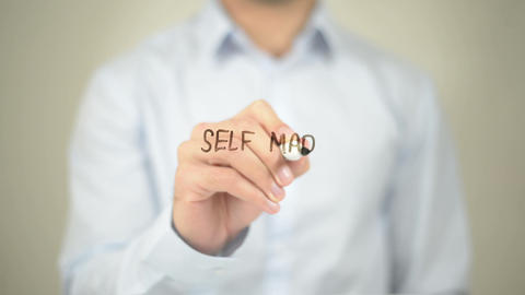 Self Made Millionare, Man Writing On Transparent Screen stock footage