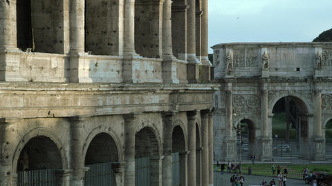Panning shot close up of Colosseum to Arch of Constantine Footage