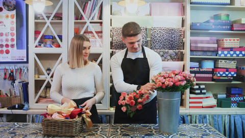 Young couple work at flower shop Live Action