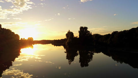 Sunset scenery lake reflection sunrise smooth water surface flyover Live Action