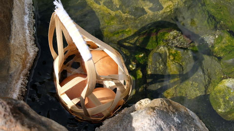 Boiled eggs with Round bamboo basket in hot spring and smoke at Chaeson National Park, Mueang Pan, Footage