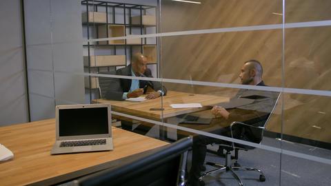 Team of aframerican and caucasian bussines people in boardroom Footage