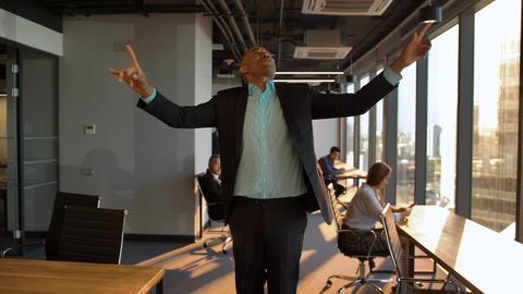 Atractive Aframerican businessman celebrating promotion with funny dance walk Footage