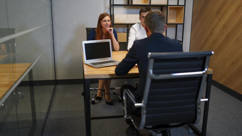 The male and female talking with lawyer in bank boardroom Footage