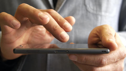 male hands use smartphone touchscreen Live Action