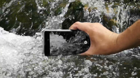 Slow motion video of the hand that makes video of water in the water flow Footage