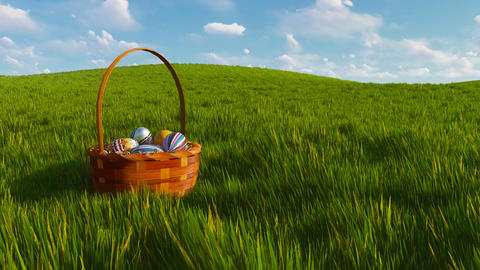Easter basket with colorful eggs among green grass Footage