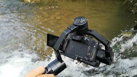 Mirrorless camera with electronical gimbal shooting waterfall in slow motion Footage