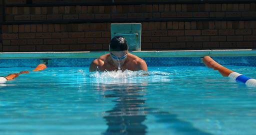 Male swimmer swimming inside pool 4k Live Action