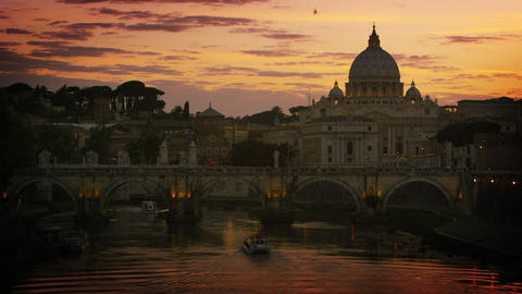 A boat travels under the Ponte Sant'Angelo at dusk. Dome of St. Peter's Basilica Footage