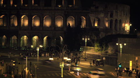 Vehicles and pedestrians in front of Colosseum at night Footage