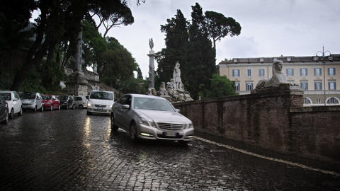 Northeast wet cobble road curving around the Piazza del Popolo Footage