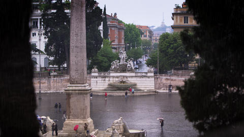 Distant shot of Fontana del Nottuno and obelisk at Piazza del Popolo Footage