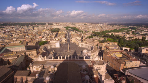 Aerial footage of St. Peter's plaza and the rooftops of Rome Footage