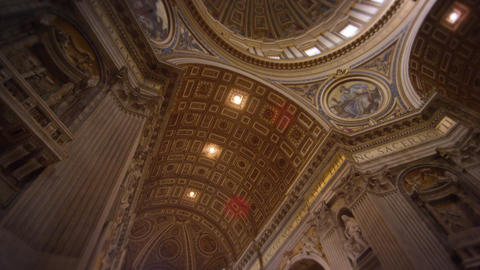 Rotate and tilt down footage of interior of St Peter's Footage