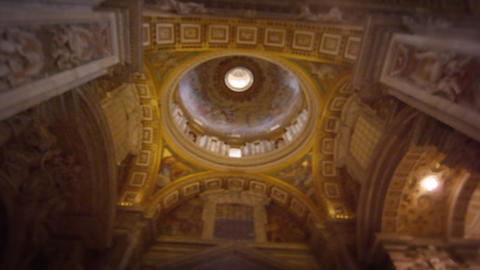 Rotating footage of a ceiling and a dome interior of St Peter's Basilica Footage