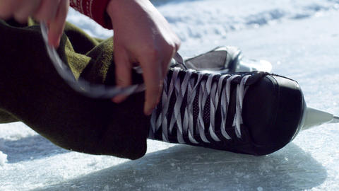 Close up of a hockey skate being tied at an outdoor rink Footage
