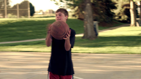Royalty Free Stock Footage of Dad and boy playing basketball in a park Footage