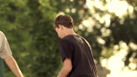 Royalty Free Stock Footage of Dad and son playing basketball in a park Footage