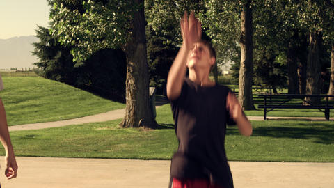 Royalty Free Stock Footage of Father playing basketball with his son in the park Footage