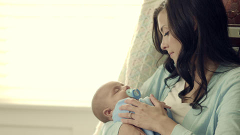 Royalty Free Stock Footage of Mother and baby in a rocking chair Footage