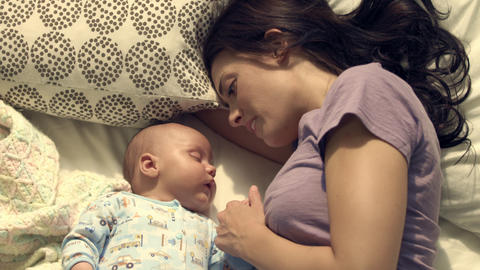 Royalty Free Stock Footage of Baby and mother in bed Live Action
