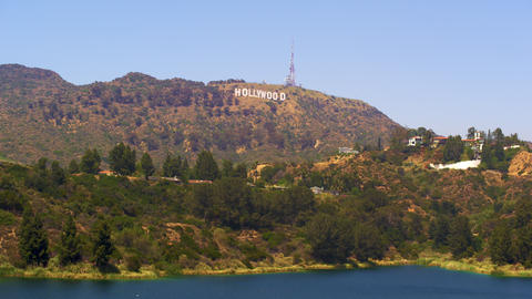 Long distance static shot of the Hollywood sign with a body of water in the fore Footage