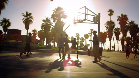 Slow motion and lens flare shot of a basketball game near Venice Beach, Californ Footage