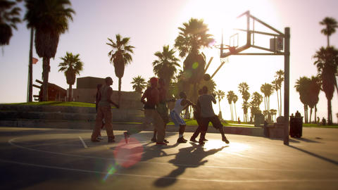 Men playing basketball near Venice Beach, California filmed in slow motion Footage