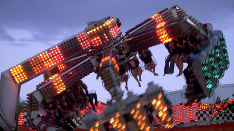 Shot of people flying through the air on a carnival ride Footage