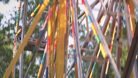 Shot of two couples on a ferris wheel at a carnival Footage