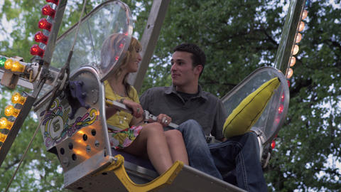 Shot of couple talking on a stopped ferris wheel Footage