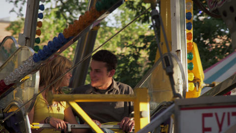 Girl and boy talk on ferris wheel before it starts turning Footage