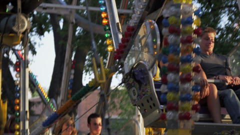 Slow motion shot of a couple riding around on a ferris wheel Footage