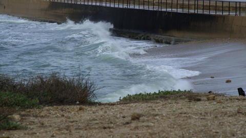 Royalty Free Stock Video Footage of waves hitting a coastal barrier shot in Isra Footage