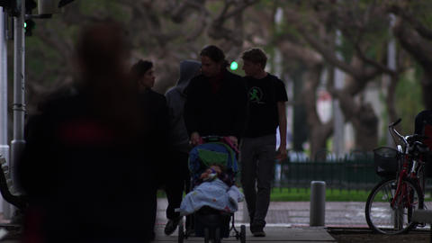 Stock Video Footage of Tel Aviv residents walking with strollers shot in Israel  Footage