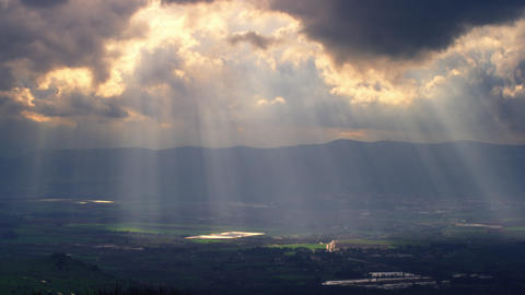 Stock Video Footage panorama of sun rays illuminating a valley shot in Israel at Footage
