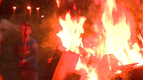 Boy with burning stick and pretty girl take photo of fire bonfire GIF