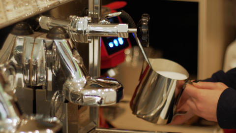 Beating milk froth in a professional coffee machine Live Action
